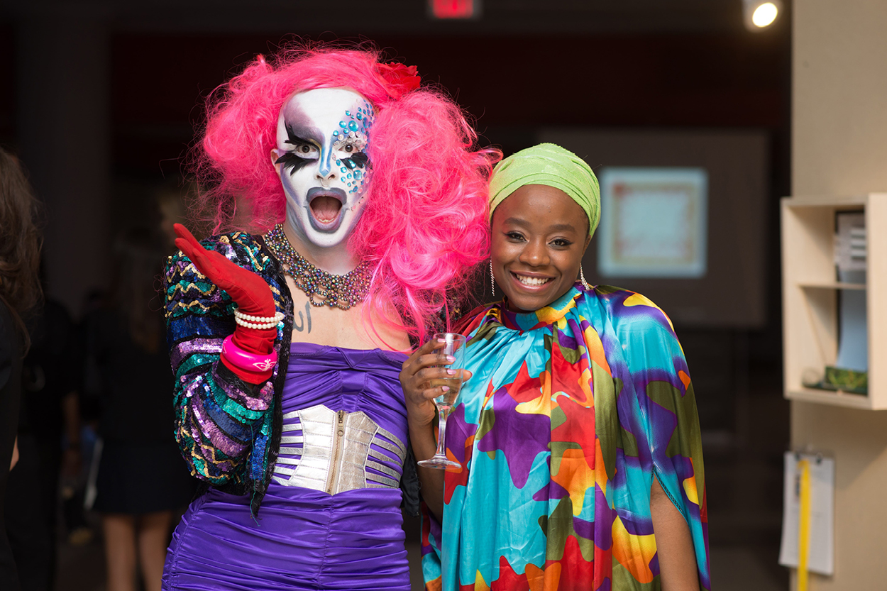 Drag queen posing with party goer