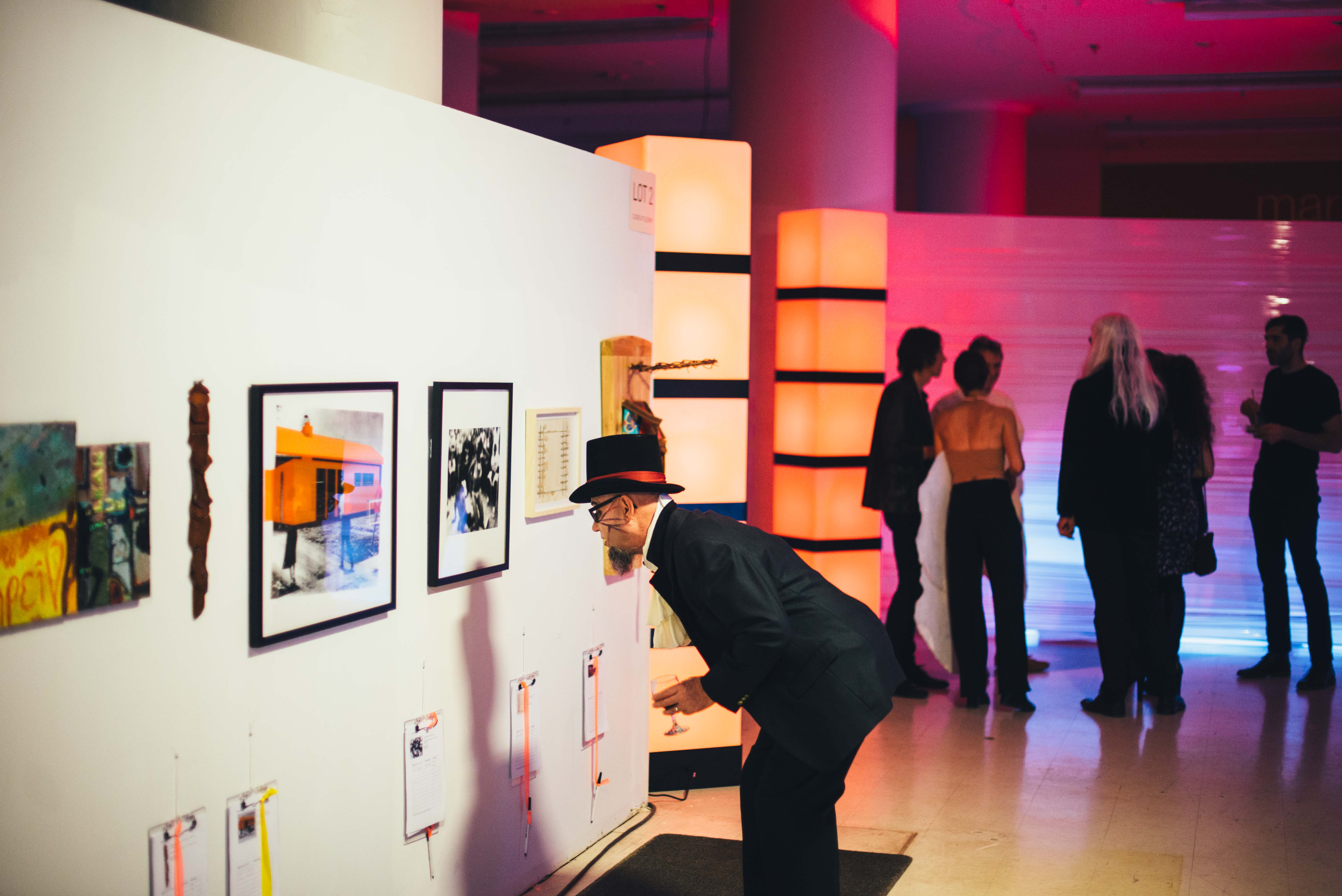 Man in costume looking at art work 2018 GALA