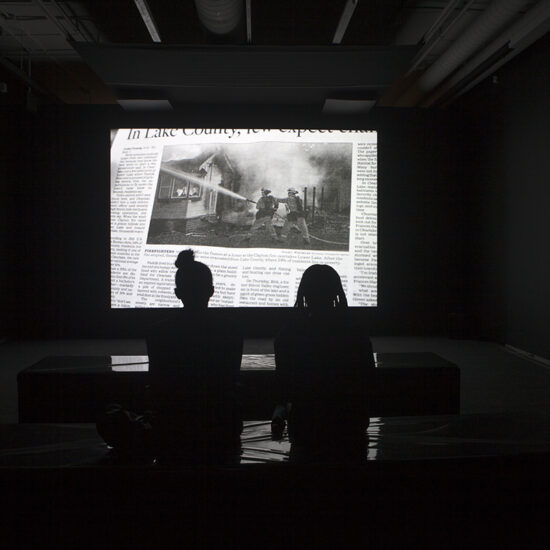 Two viewers standing in front of a scene from the Modernist.