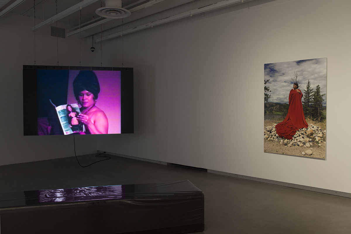 Video performance and print of Lori Blondeau displayed in the gallery