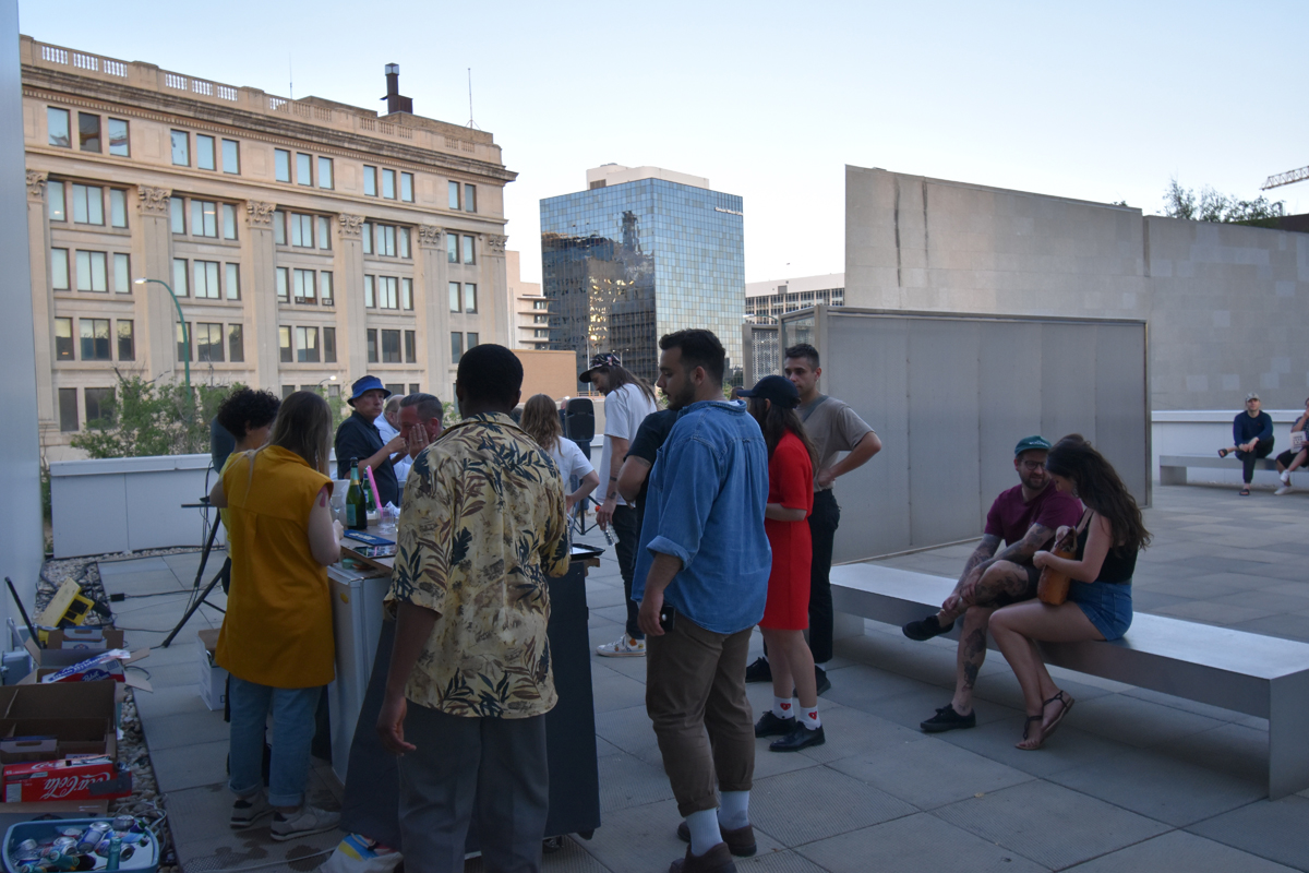Photo of a roof top gathering, 2019