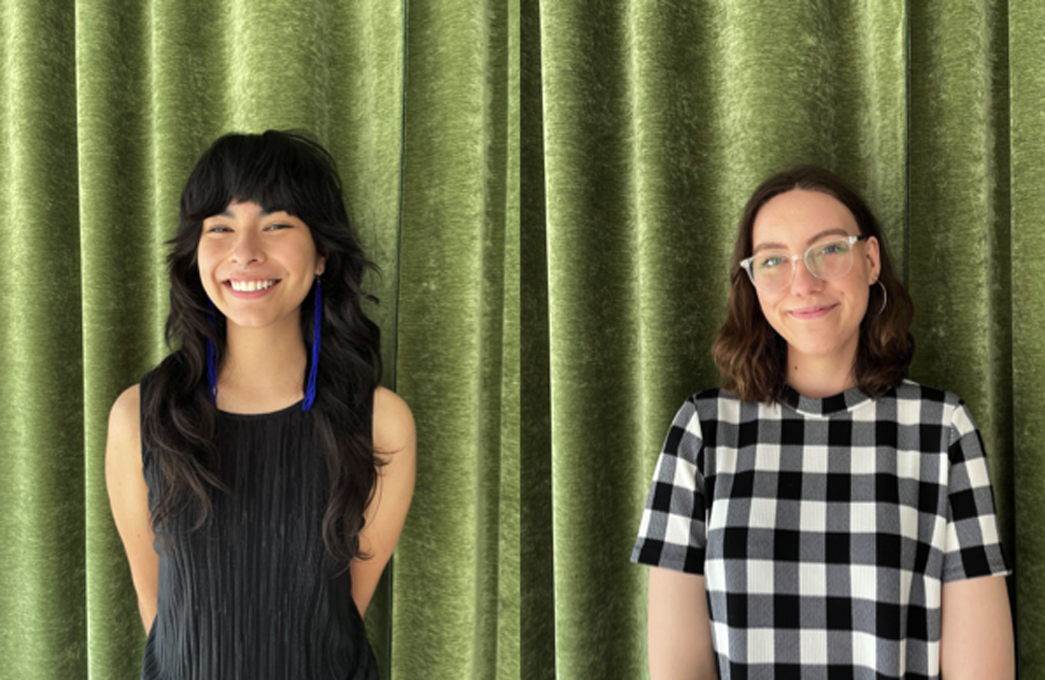 Photo of two smiling women in front of a green velvet curtain